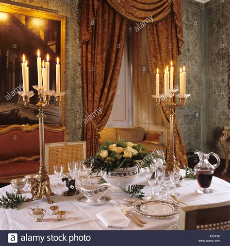 dinner table set set dinner table with candle light in a palazzo