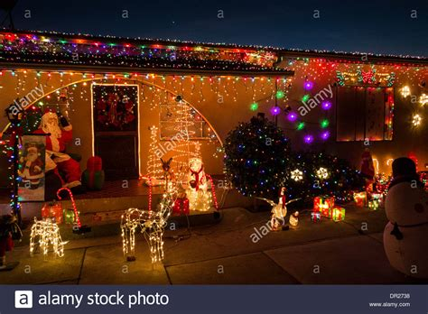home decorated with christmas lights and decorations on