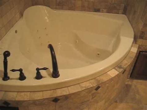 corner bathtub with seat