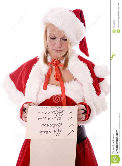 santa s helper santas helper looking at list serious royalty free stock photos image 11940308