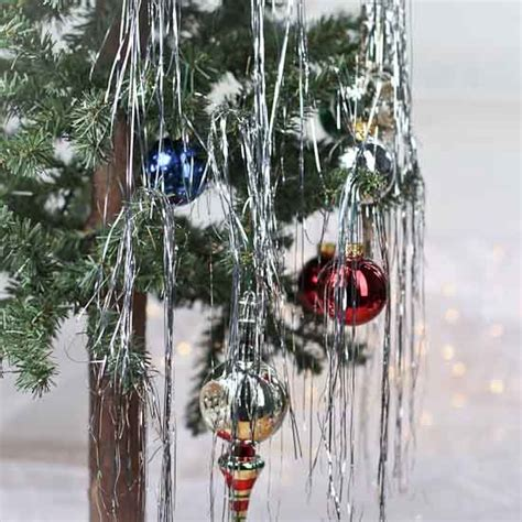 vintage christmas rope and tinsel retro inspired silver metallic tinsel strands garlands and winter