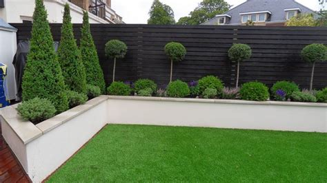 White Garden Walls Black Window Frames White Render Timber Fence