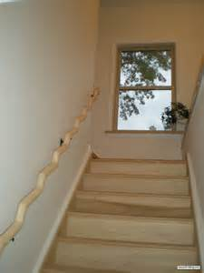 wooden banister wavy wood banister installed and it looks awesome