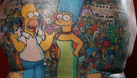 cartoon tattoo artist australia australian man has 203 simpsons characters tattooed on his