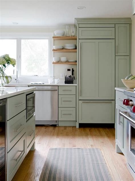 Green Kitchens With White Cabinets Beautiful Kitchen Features Green Cabinets Paired With White Quartz Countertops A