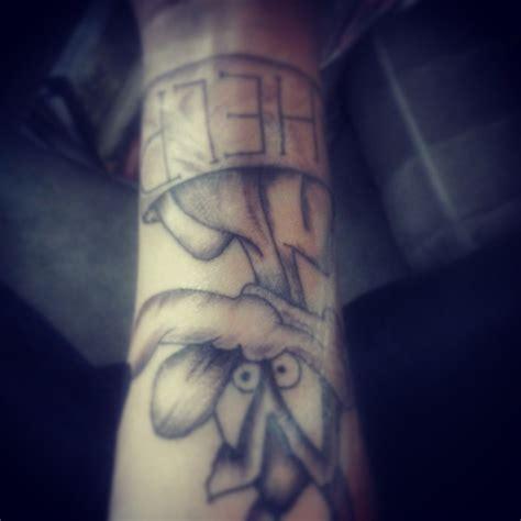 cartoon tattoo forearm grey ink coyote cartoon tattoo on forearm