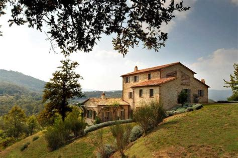 italy houses stone home with tile roof on an italian hillside