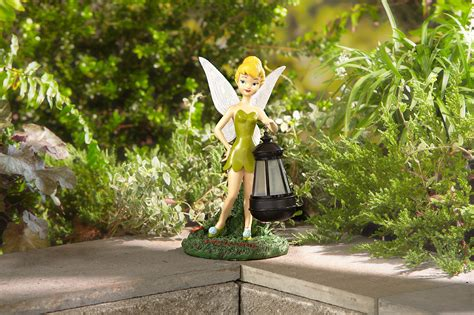 disney statue with solar lantern tinkerbell outdoor living outdoor decor lawn ornaments