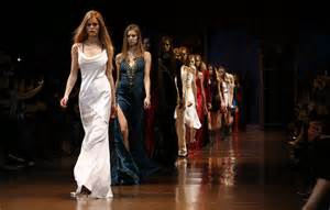 milan fashion week 2014 armani and versace put opulent