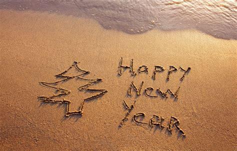 wallpaper happy happy new year beach beach sea sand