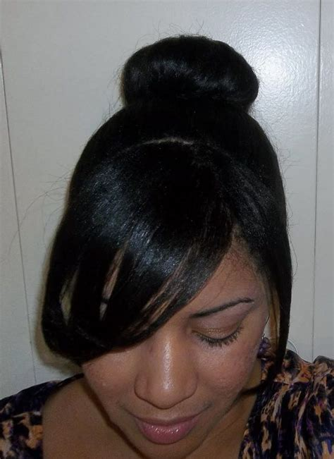 black lady bun with bangs black hair bun and side bangs women hairstyles ideas