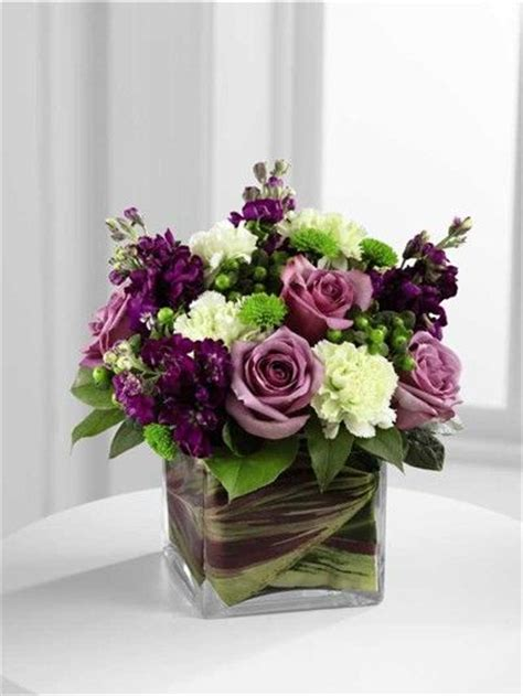 purple flower arrangements centerpieces 25 best ideas about square vase centerpieces on
