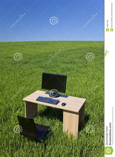 Desk In The Field by Desk And Computer In Green Field With Blue Sky Royalty