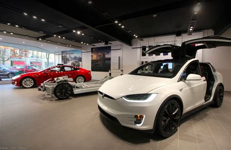 tesla lowers price  model       pd
