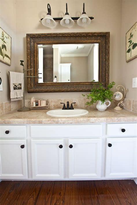 farmhouse bathroom updates towels flower  vanities