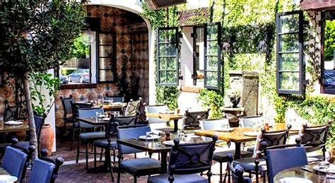 Houston Garden And Patio Outdoor Restaurant With Wooden Tables And Chairs In The