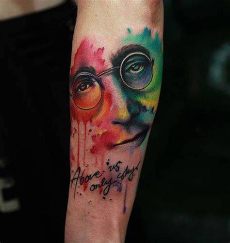 john tattoo on wrist above us only sky john lennon best tattoo design ideas