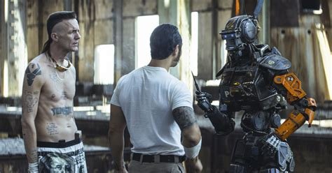 film robot chappie full movie new chappie images highlight hugh jackman s mullet collider