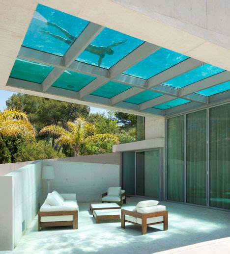 Glazed Bookcases Jellyfish House Cantilevered Rooftop Pool With Glass Floor