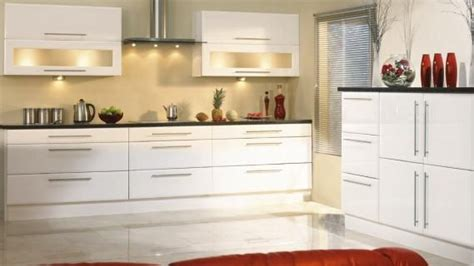 kitchen cabinets with long handles white units long handles glazed doors dark work tops