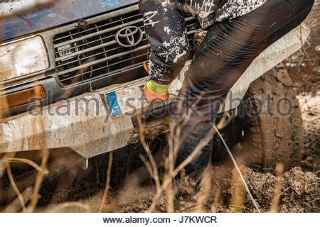 white jeep stuck in mud jeep wrangler get stuck in mud stock photo royalty free