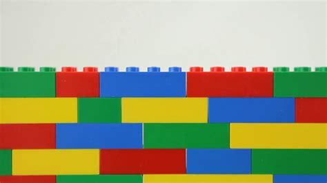 lego background adding yellow block to multicoloured lego wall white
