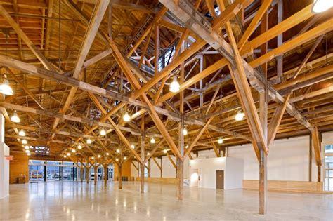 large timber trusses salt building restoration 2010 olympic village vancouver