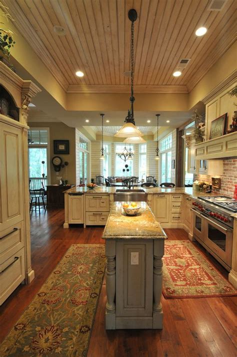 center kitchen islands southern coastal homes with a bigger center island though