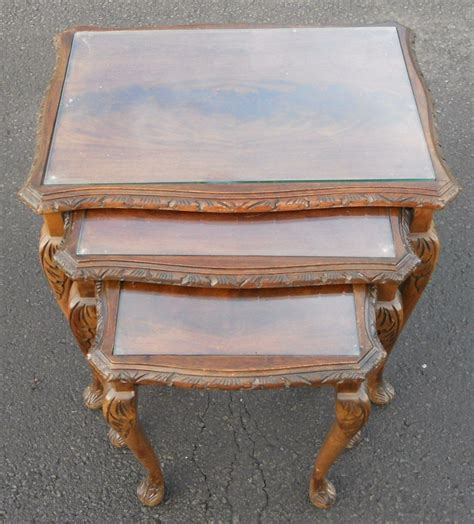 nest of three mahogany glass top coffee tables