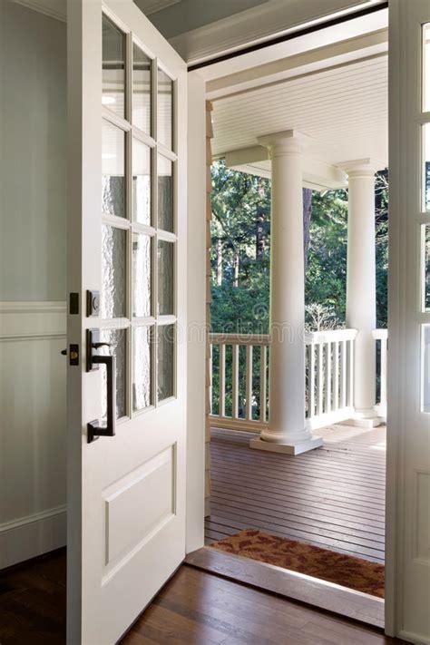 vertical shot   open wooden front door stock image