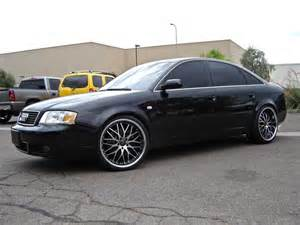 white audi a6 black rims