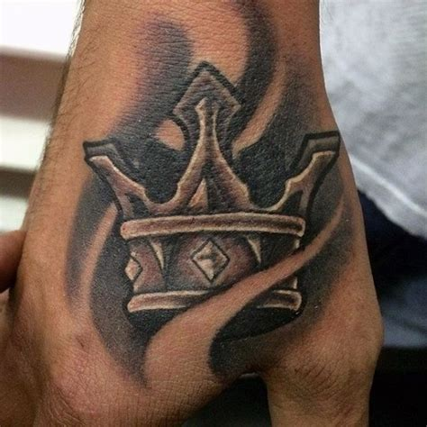 hand tattoos for guys 100 crown tattoos for kingly design ideas
