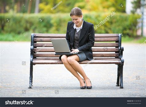 sitting on the bench image elegant employer sitting on bench stock photo