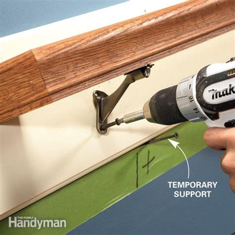 how to attach banister to wall how to fix loose stair handrails the family handyman