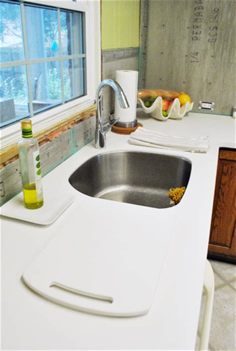 Can You Put Pots On Corian our white corian counters are in and we them house