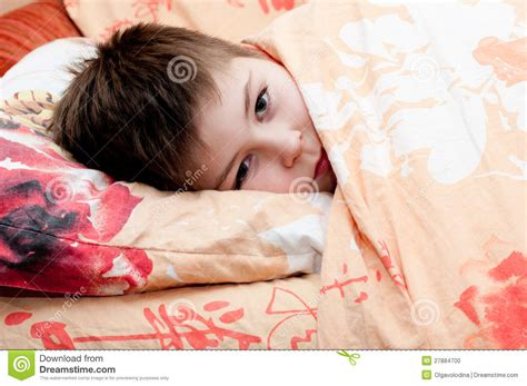 sick in bed images sick boy lying in bed stock photo image 27884700
