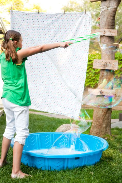 backyard bubble one charming party birthday party ideas bubble party