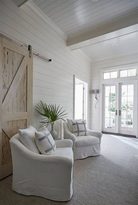 beach home bedroom with pecky cypress barn door on rails florida beach house with new coastal design ideas the
