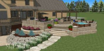 This paver patio have lots of curves but it is also tiered and raised