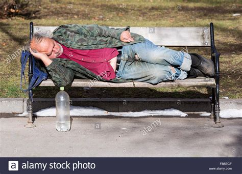homeless man on bench sofia bulgaria january 8 2016 a homeless man is