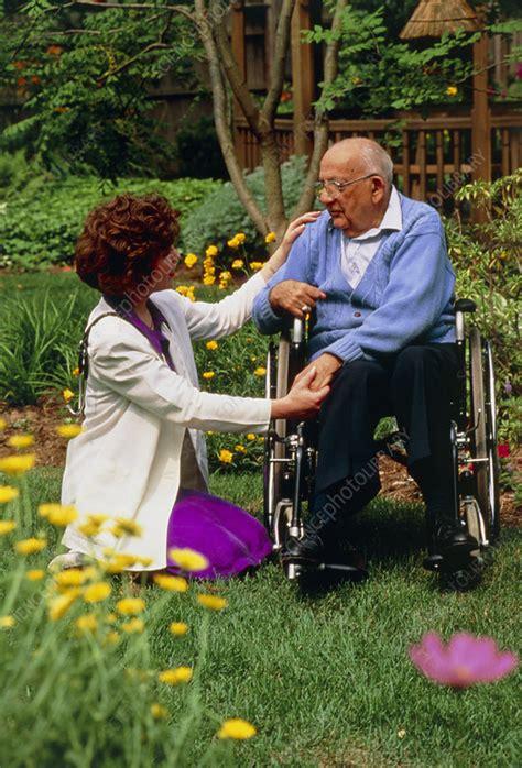 disabled elderly man receiving home visit stock image