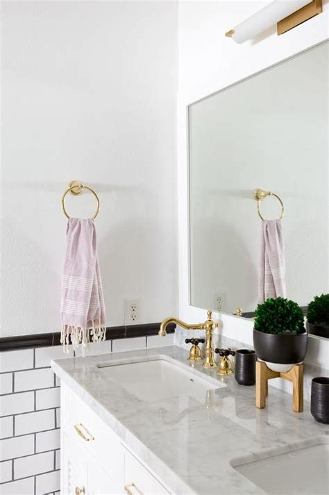 white and gold bathroom bathroom white subway tiles with gray grout transitional bathroom