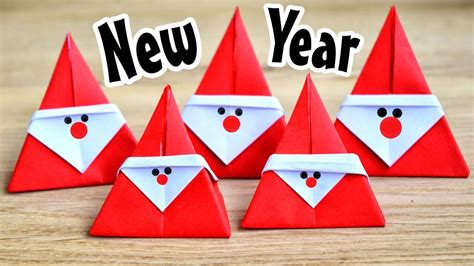 New Year Origami - simple santa claus from the paper new year origami