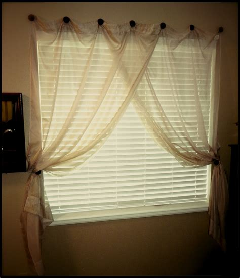 where to hang curtain rods hang curtain rod decorating use ribbon to hang frames