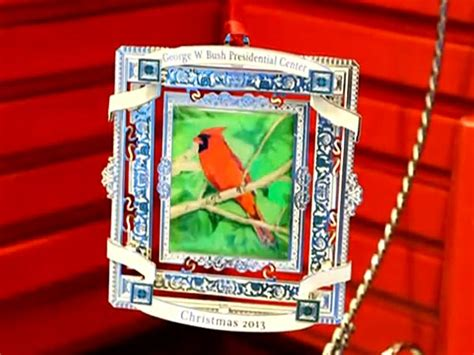 george w bush selling christmas ornament with cardinal