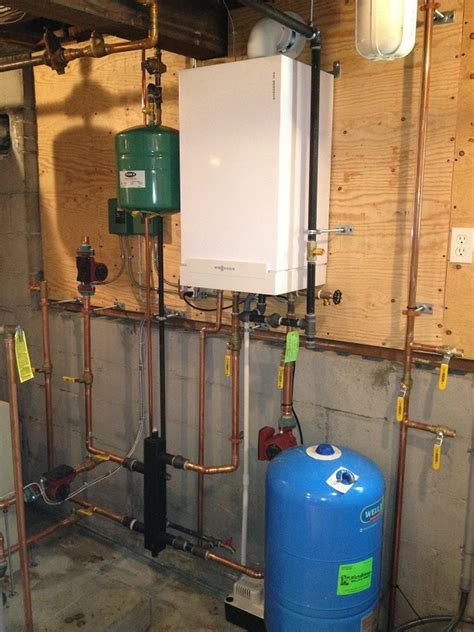 Kaufman Plumbing by New Veissman Boiler Installed By Our Master Plumber In