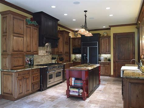 red kitchen cabinets with black glaze perimeter cabinets acorn rustic maple with black glaze