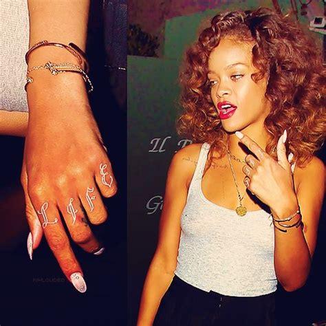 rihannas tattoos rihanna s infamous thug knuckles