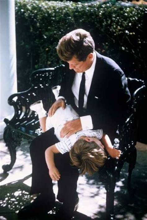 daddy spanks president john f kennedy pretending to spank his son