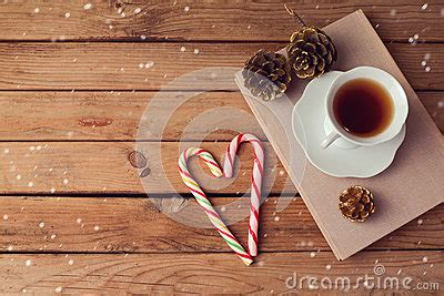 how many copies of a cup of christmas tea sold tea cup on books with shaped on wooden table with copy space